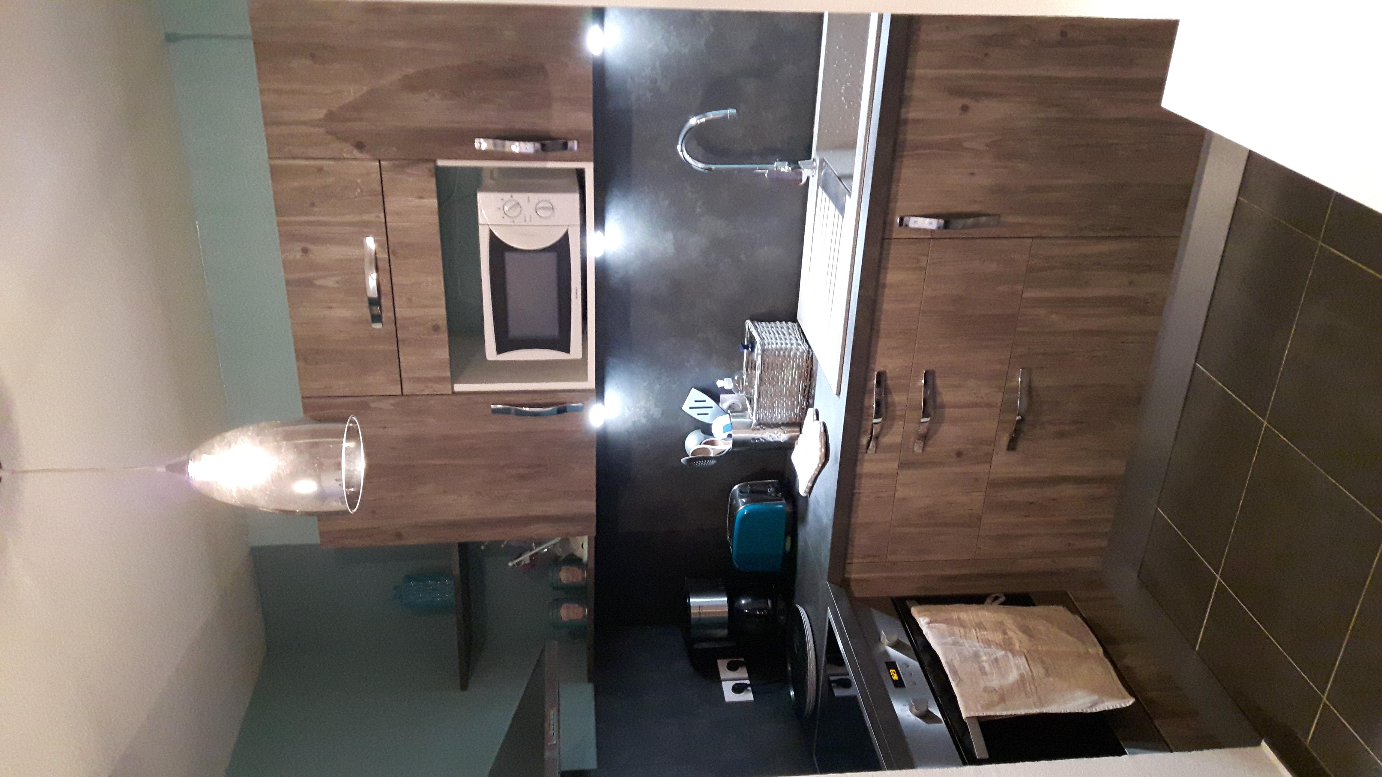 cuisine haut de gamme bois flott. Black Bedroom Furniture Sets. Home Design Ideas